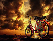 Bicycle parking under cloudy skies — Stock Photo