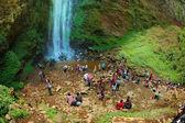 Tourist having fun beside waterfall — Stock Photo