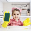 Smiling little housewife — Stock Photo