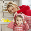 Stock Photo: Helping girl, learning housework