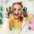 Stock Photo: Beautiful girl playing with colors
