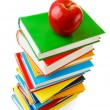Stack of books with an apple — Stock Photo