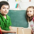 School children on chalkboard — Stock Photo #29573695