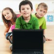 School children with laptop — Stock Photo
