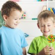 Stock Photo: Two little boys and one lollipop