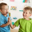 Two little boys and one lollipop — Stock Photo #29573707