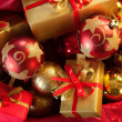 Foto Stock: Christmas baubles and gifts