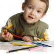 Cute boy draw with color crayons — Stock Photo #29574527