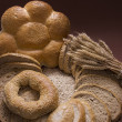 Assortment of baked bread and wheat — Stock Photo