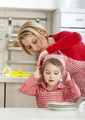 Helping girl, learning housework — Stock Photo