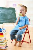 Schoolboy and lollipop — Stock Photo