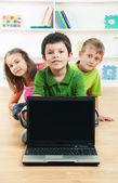 School children with laptop — Stock Photo