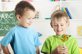 Two little boys and one lollipop — Stock Photo