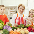Happy family in the kitchen — Stock Photo