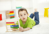 Preschooler learning on abacus — Stock Photo