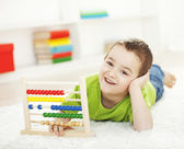 Little boy learning and smiling — Stock Photo