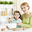 Stock Photo: Mother and Daughter Baking in the Kitchen