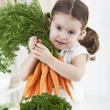Stock Photo: Little girl with carrot