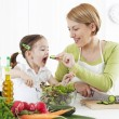 Stock Photo: Mother and child makeing salad