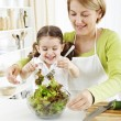 Stock Photo: Mother and daughter in the kitchen