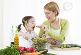 Mother and child makeing salad — Stock Photo
