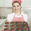 Beautiful woman baking in the kitchen — Stock Photo #29856673