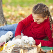 Girl playing with her puppies — Stok fotoğraf