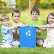 Stock Photo: Childdren on grass with recycling symbol