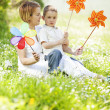 Mother and son playing with pinwheel — Stock Photo