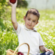 Little boy with red apple. — Stock Photo