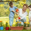 Mother and two children gardening — Stock Photo #30442161