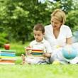 Learning in the park. mother and son — Stock Photo
