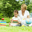 Stock Photo: Learning in the park. mother and son