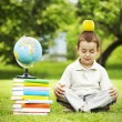 Little schoolboy in zen meditation — Stock Photo