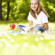 Teenage girl with books in the park — Stock Photo
