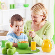 Smiling Morning. Breacfast. Mother and son — Stock Photo #31114411