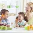 Family eating fruit it is healthy — Stock Photo