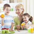 Family with fruits — Stock Photo