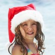 Child dressed in a Santa Claus hat — Stock Photo