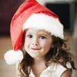 Beutiful little girl in santa hat — Stock Photo