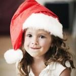 Beutiful little girl in santa hat — Stock Photo