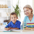 Stock Photo: Mother and son learning math