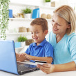 Mother and son looking at computer — Stock Photo