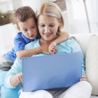 Mother and son with a laptop — Stock Photo