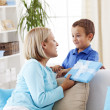Mother giving gift for her son — Stock Photo