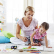 Mother and child painting together — Stock Photo #31117663