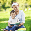 Reading in park — Stock Photo