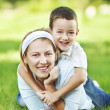 Mother and son having fun in the park — Stock Photo #31118563