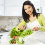 Smiling woman preparing salad — Stock Photo