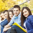 Group of college students sitting at campus — Stock Photo